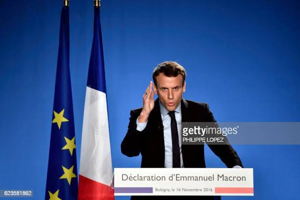 TOPSHOT Former French Economy Minister Emmanuel Macron delivers a speech during a press conference to announce his candidacy for next year's...