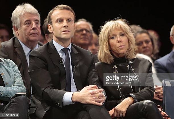 Former French Economy Minister Emmanuel Macron with his wife Brigitte Macron during a meeting of his political movement 'En Marche' on October 18...