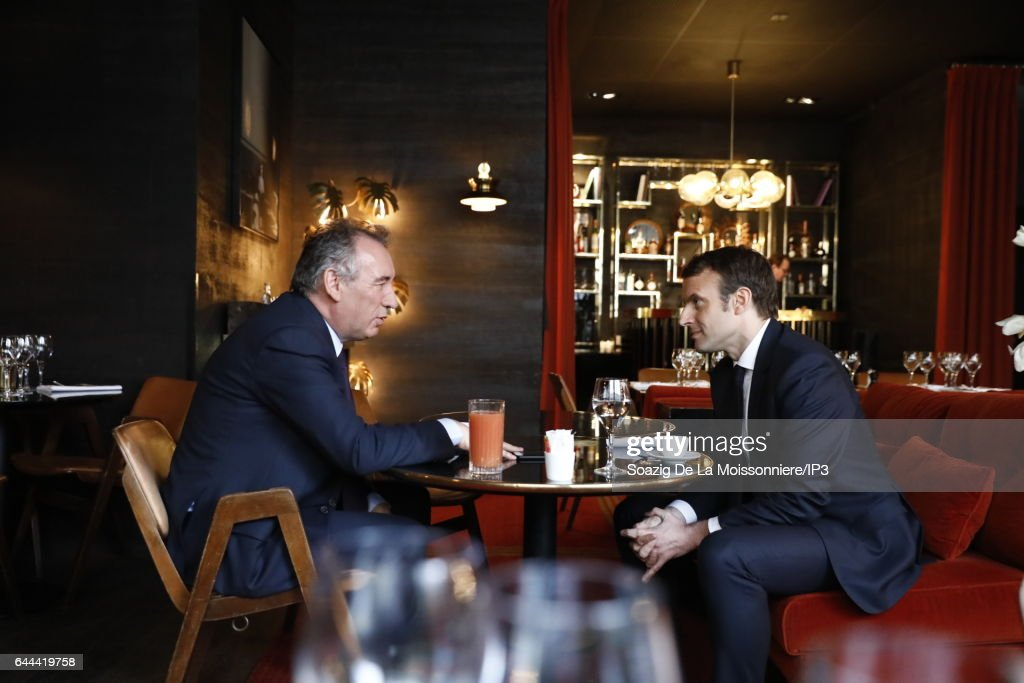 Former French Economy Minister, Founder and Leader of the political movement 'En Marche !' and candidate for the 2017 French Presidential Election Emmanuel Macron (R) meets Mayor of Pau and President of the MoDem, a centrist political movement Francois Bayrou (L), to formalize their political alliance at the Palais de Tokyo on February 23, 2017 in Paris, France. The day before, Francois Bayrou announced that he would not run for the French Presidential Election and proposed an alliance to Emmanuel Macron who accepted it.