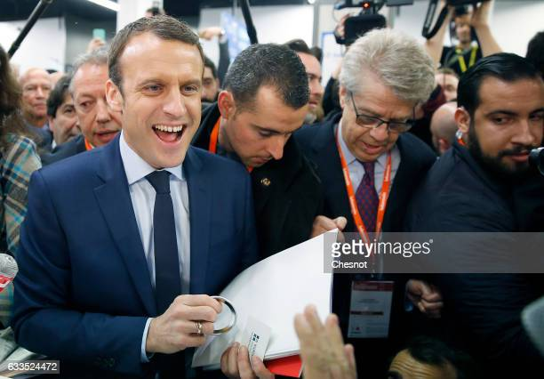Former French Economy Minister founder and President of the political movement 'En Marche ' Emmanuel Macron visits the innovators fair on February 2...
