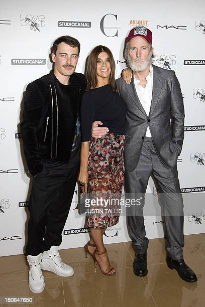 Former French editorinchief of Vogue Paris Carine Roitfeld poses for pictures with director Fabien Constant and British actor Aiden Shaw as they...