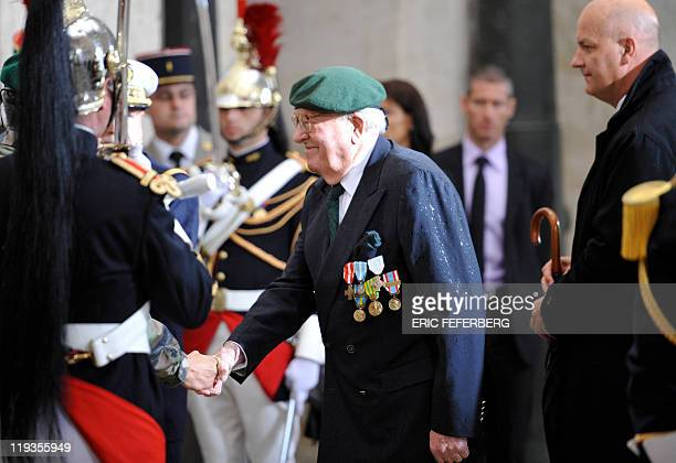 Former French far right Front national party leader JeanMarie Le Pen wearing the green beret of Legion etrangere paratroopers as former soldier...