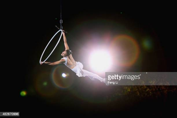 Former French figure skater Marie Pierre Leray on trapeze performs during Artistry On Ice 2014 on July 25 2014 in Beijing China