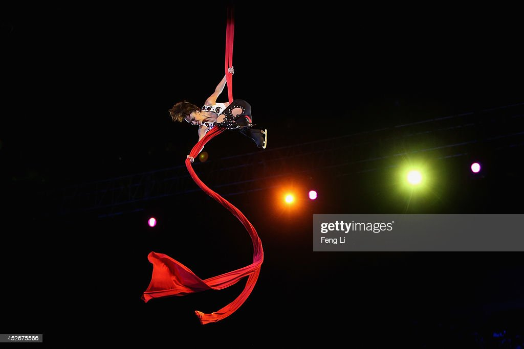 Former French figure skater Marie Pierre Leray on trapeze performs during Artistry On Ice 2014 on July 25, 2014 in Beijing, China.