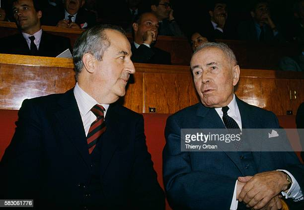 Former French Finance Minister Antoine Pinay talks with current Finance Minister Edouard Balladur at the 30th anniversary of the Economic and...