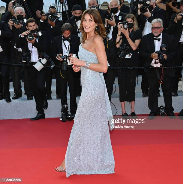 Former French first lady Carla Bruni arrives for the screening of the âfilm Annette' in competition and the Opening Ceremony of the 74th annual...