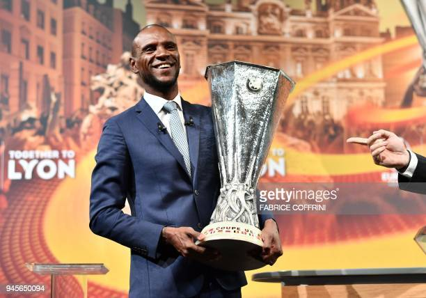 TOPSHOT Former French football player and ambassador for the UEFA Europa League final in Lyon Eric Abidal poses after the handover of the trophy...