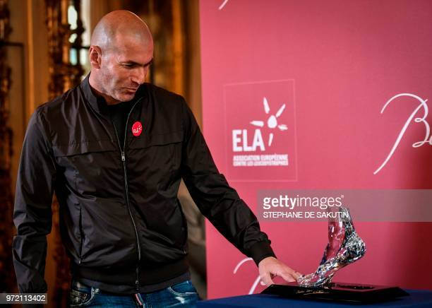 TOPSHOT Former French football player and European Leukodystrophy Association patron Zinedine Zidane poses with the 'Zidane's Crystal Foot' created...
