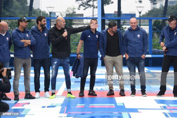 Former French football player and former Real Madrid coach Zinedine Zidane presents his teammates of the France's 1998 World Cup's French football...