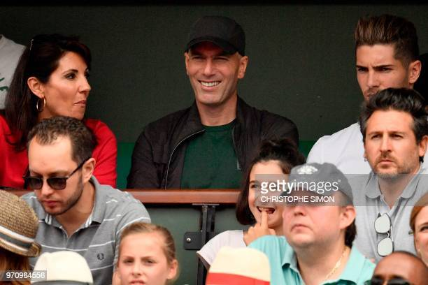 TOPSHOT Former French football player and former Real Madrid's coach Zinedine Zidane flanked by his wife Veronique and their son Real Madrid's French...