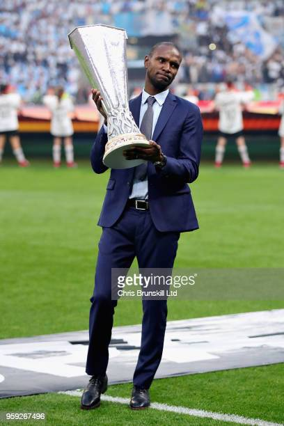 Former French football player Eric Abidal holds the UEFA Europa league trophy before the UEFA Europa League Final between Olympique de Marseille and...