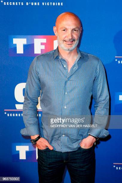Former French football player Frank Leboeuf poses as he arrives to attend the premiere of the television documentary film '98 secrets d'une victoire'...