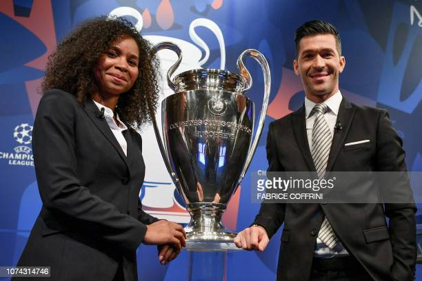 Former French football player Laura Georges and Former Spanish football player Luis Garcia pose with the UEFA Champions League football cup after the...