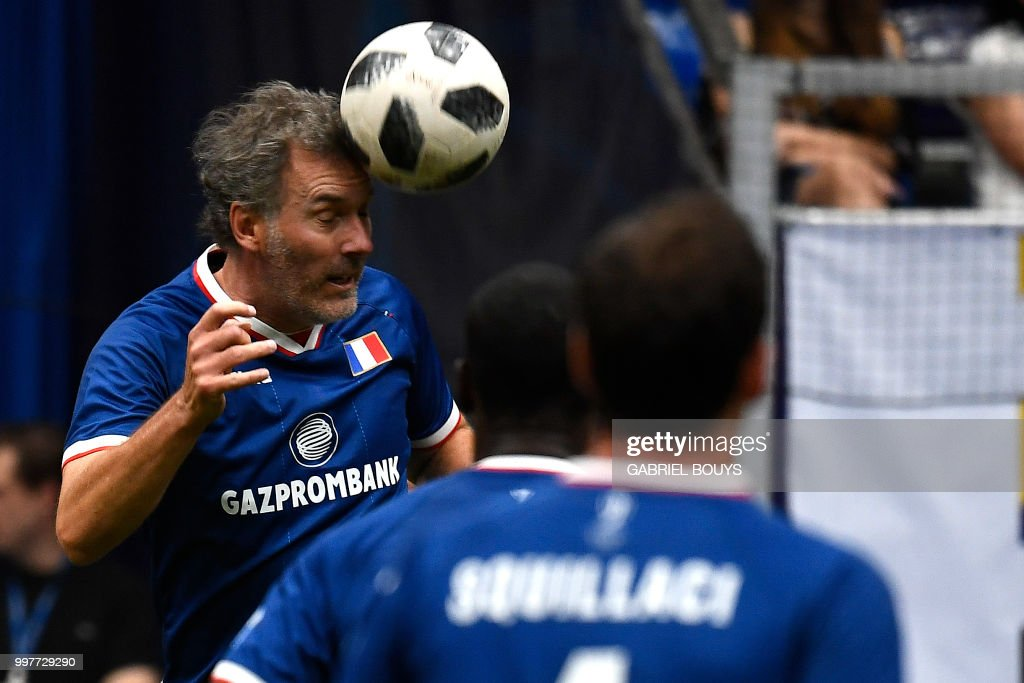 Former French Football Player Laurent Blanc Heads The Ball During The Legends Super Cup Futsal Match