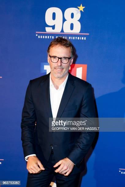 Former French football player Laurent Blanc poses as he arrives to attend the premiere of the television documentary film 98 secrets d'une victoire...