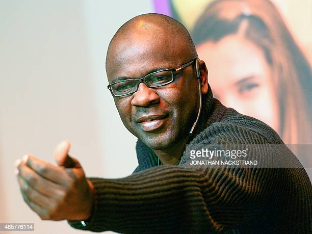 Former French football player Lilian Thuram speaks and answers question during a session with pupils at the Rinkeby school on March 10 2015 in...