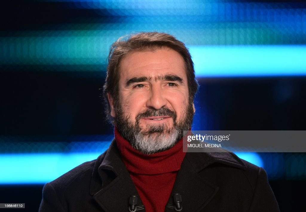 Former French football player turned actor Eric Cantona hosts the TV show 'Le grand journal' on a set of French TV Canal+, on November 22, 2012 in Paris as part of the launching of the French charity association Abbe Pierre Foundation's winter campaign. AFP PHOTO / MIGUEL MEDINA / AFP PHOTO / Miguel MEDINA