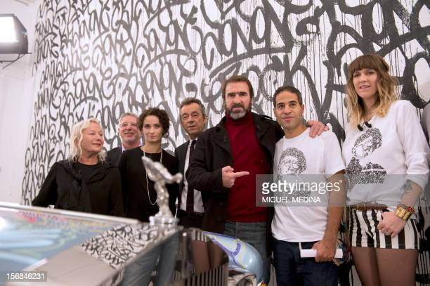 Former French football player turned actor Eric Cantona poses with US graffiti artist Jonone surrounded by French designer Agnes B French actress...
