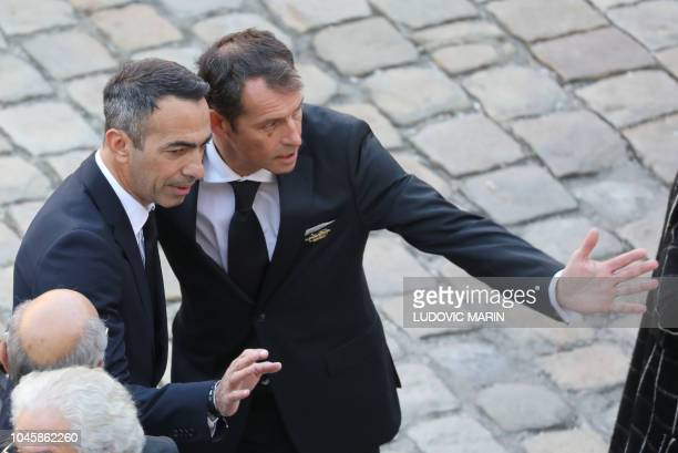 Former French football player Youri Djorkaeff arrives to attend the National homage to Charles Aznavour on October 5 2018 at the Hotel des Invalides...
