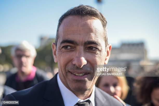 Former French football player Youri Djorkaeff attends the national homage to FrenchArmenian singersongwriter Charles Aznavour at the Invalides in...
