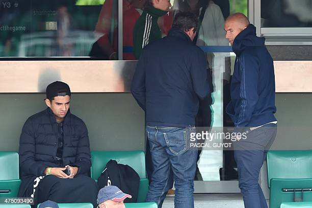 Former French football player Zinedine Zidane and his son Enzo watch the match between Croatia's Mirjana LucicBaroni and France's Alize Cornet's...