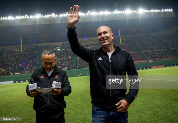 Former French football player Zinedine Zidane waves to the crowd at promotional event for the Chinese University of Football Association in Guangzhou...