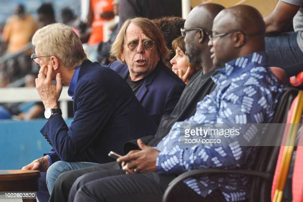 Former French football players and coaches Claude LeRoy and Arsene Wenger attend with Liberian President George Weah a football match in Monrovia on...