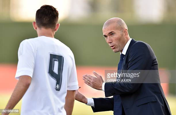 Former French football star and coach of Real Madrid Castilla Zinedine Zidane gives an instruction to Real Madrid Castilla's player Mayoral during...