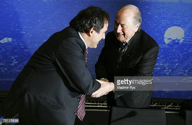 Former French football star Michel Platini shakes hands with FIFA President Sepp Blatter during the second day of the 2007 UEFA Congress at the...