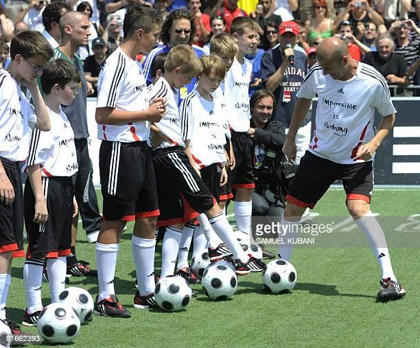 Former French football star Zinedine Zidane plays football with children on June 22 2008 in Vienna Zidane held a football clinic for children in...