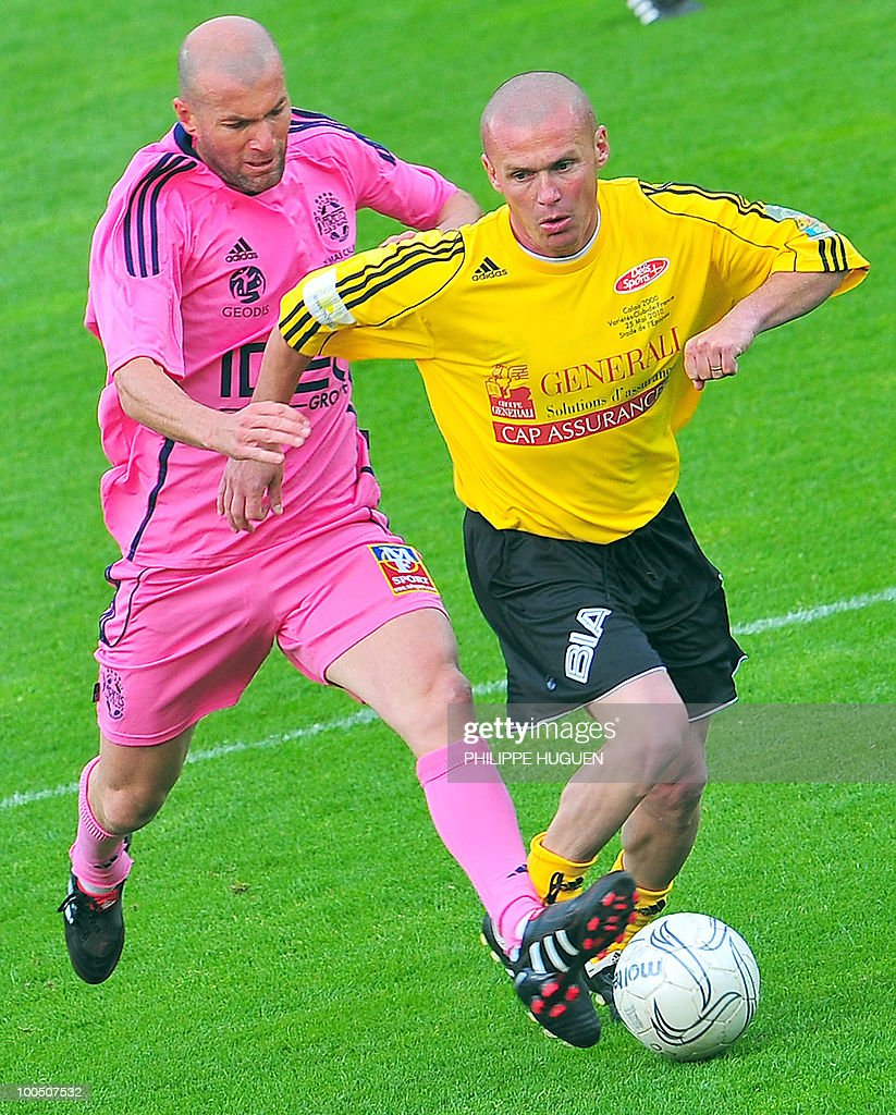Former French football star Zinedine Zidane (L) vies with Calais' defender Donat Darcy during the football exhibition match Calais vs. Varietes Club de France, on May 25, 2010 at the Epopee stadium in Calais, northern France. This exhibition match between Calais and a team made up of French 1998 World Cup champions stands to commemorate amateur team of Calais epic run to the final of the 2000 Coupe de France.