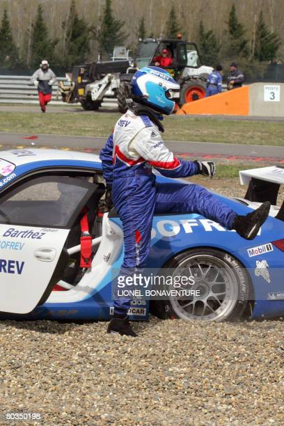 Former French football team goalkeeper Fabien Barthez reacts after sliding off with his car in the first curve of the Nogaro ring during the Porsche...