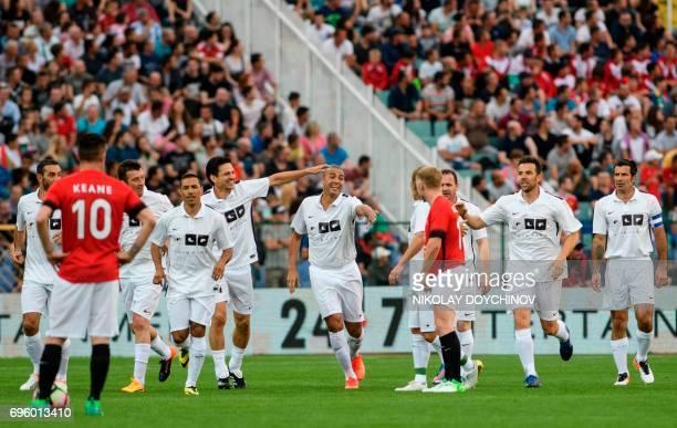 Former French footballer David Trezeguet celebrates after scoring with teamates Luis Figo Carlos Marchena Michel Salgado Jari Litmanen Ivan Cordoba...