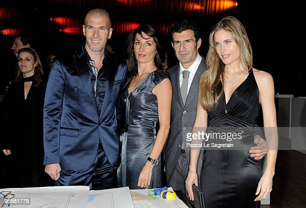 Former French footballer Zinedine Zidane and wife Veronique Zidane pose with former Portuguese footballer Luis Figo and wife Helen Svedin at the IWC...