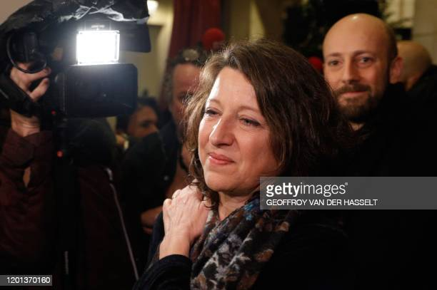 Former French Health Minister Agnes Buzyn poses for pictures as she arrives at the Mon Paris cafe in Paris on February 16 after she had been chosen...