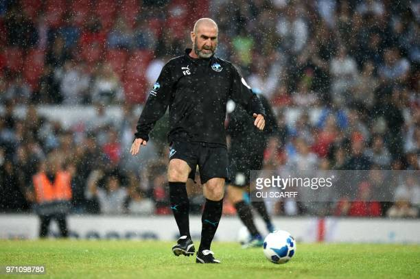 Former French international Eric Cantona looks on before an England V Soccer Aid World XI charity football match for Soccer Aid for Unicef at Old...