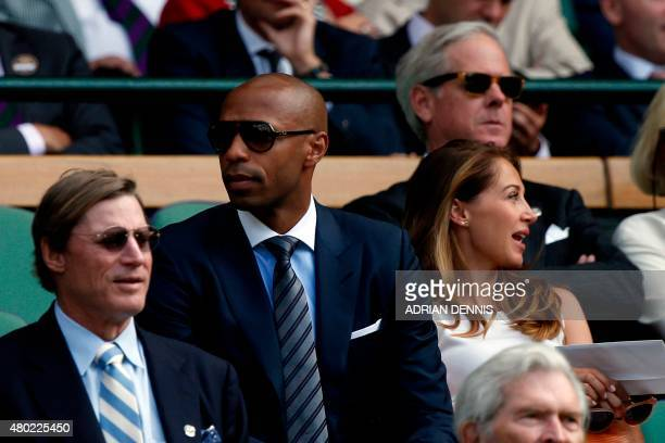 former French international football play Thierry Henry sits with Andrea Rajacic his pregnant girlfriend on Centre Court as they watch Switzerland's...