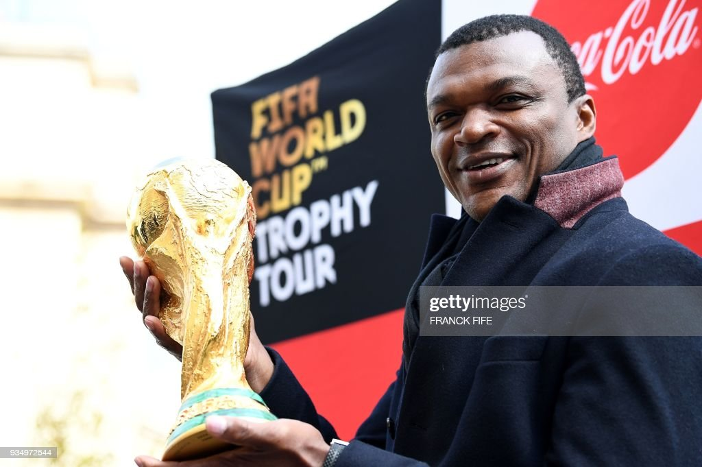 Former French international football player Marcel Desailly poses by the FIFA World Cup trophy during the FIFA World Cup Trophy Tour on March 20, 2018 in Paris. The 2018 FIFA World Cup will be held from June 14 and July 15, 2018, in 11 Russian cities. /