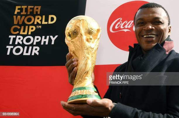 Former French international football player Marcel Desailly poses with the FIFA World Cup trophy during the FIFA World Cup Trophy Tour on March 20...