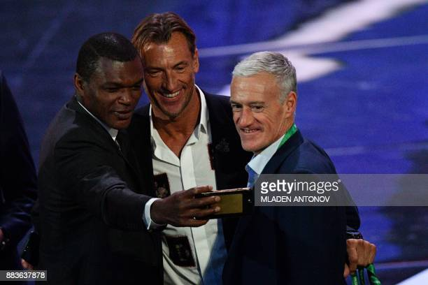 TOPSHOT Former French international Marcel Desailly Morocco's national football team coach from France Herve Renard and France's national football...