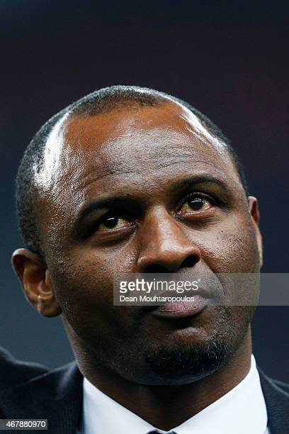 Former French international Patrick Vieira walks on the field prior to the International Friendly match between France and Brazil at the Stade de...