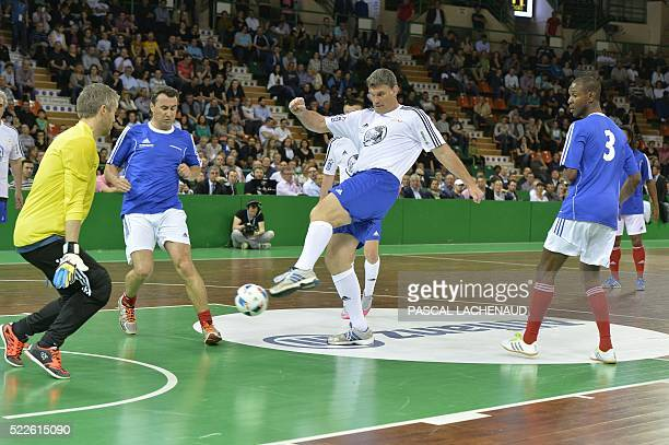 Former French International player and Stade Toulousain's general manager Fabien Pelous and from the CDES All Stars Managers team fights for the ball...