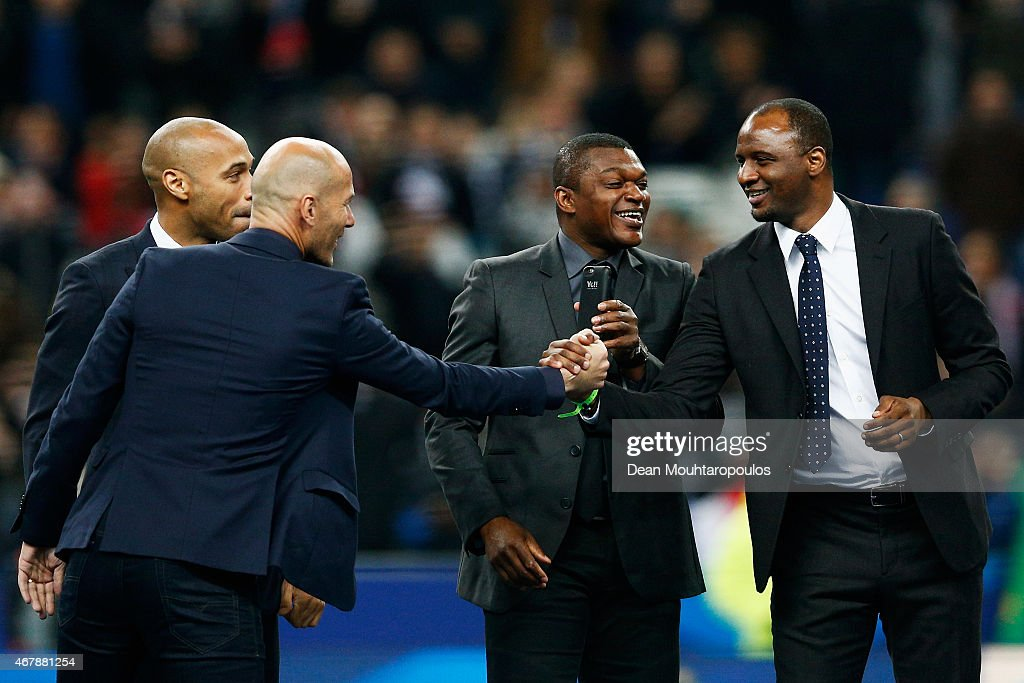 Former French internationals, (L-R) Zinedine Zidane, Thierry Henry, Marcel Desailly and Patrick Vieira share a joke as they are introduced to the fans on the field prior to the International Friendly match between France and Brazil at the Stade de France on March 26, 2015 in Paris, France.