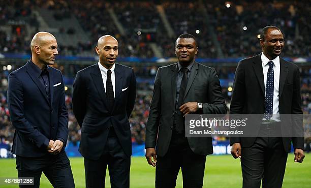Former French internationals Zinedine Zidane Thierry Henry Marcel Desailly and Patrick Vieira are introduced to the fans on the field prior to the...