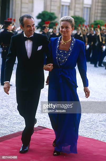 Former French justice minister and attorney general Robert Badinter and his wife enter the Elysee palace to attend an official reception with the...