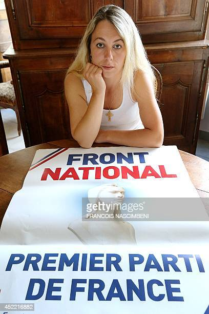 Former French local election candidate for the farright National Front party AnneSophie Leclere poses at her home on July 16 2014 in front a poster...
