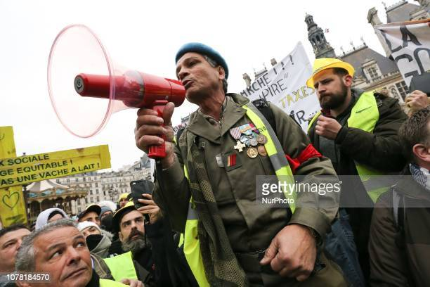 A former French military observer of United Nations observers speks during a demonstration called by the yellow vests movement for the eighth week in...