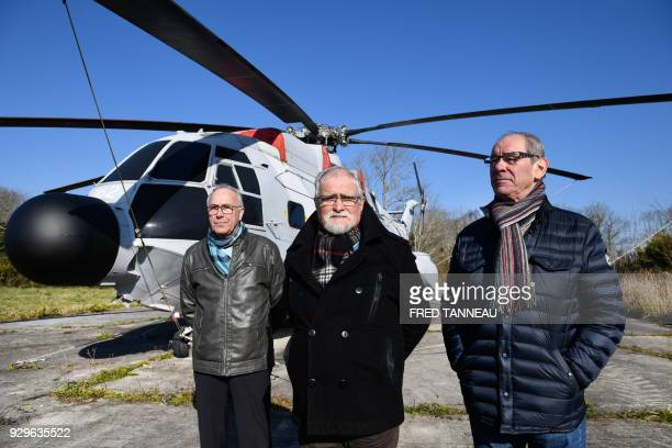 Former French navy personnel Yves Dagorn Guy Le Nabat and Michel Le Gall pose on February 23 2018 in LanveocPoulmic western France / AFP PHOTO / Fred...