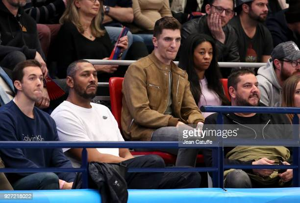 Former French NBA player Boris Diaw Thomas Meunier of PSG and his pregnant girlfriend Deborah Panzokou attend the EHF Champions League match between...