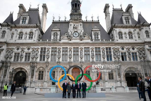 Former French Olympic champion former politician and current International Olympic Committee member Guy Drut Paris Mayor Anne Hidalgo President of...